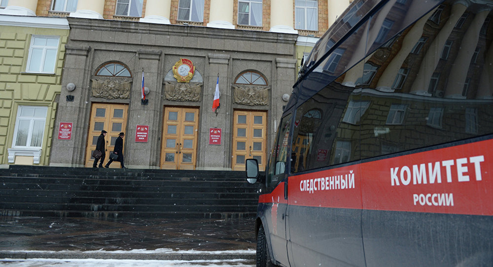 A car of the Investigative Committee is seen parked outside Novgorod Region legislature