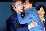 South Chungcheong governor An Hee-jung kisses South Korea's president-elect Moon Jae-in at Gwanghwamun Square in Seoul
