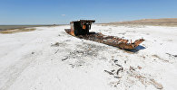 A ruined ship lays on a salinated part of the Aral Sea coastline near the village of Akespe, south-western Kazakhstan, April 16, 2017. Akespe, home to some 250 people, and Karateren, inhabited by about 150, used to be dominated by fishermen until the water receded too far away - but it is now back in Karateren.