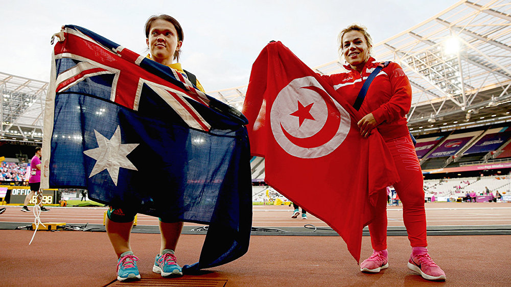 Tunisia's Raoua Tlili (R) after winning the Women's Shot Put F41 Final alongside second placed Claire Keefer of Australia