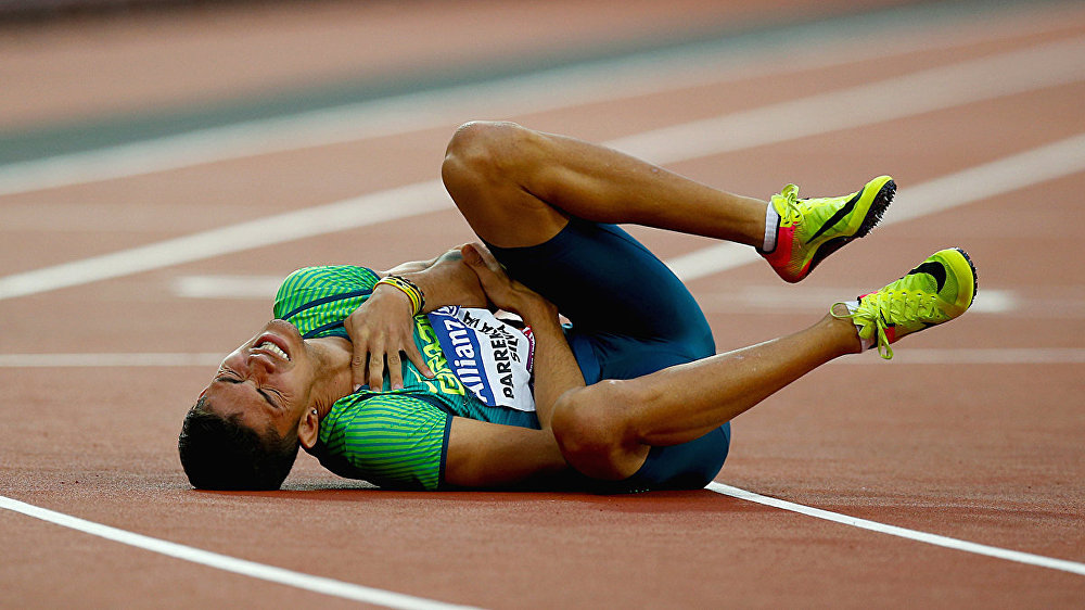 Brazil's Rodrigo Parreira Da Silva goes down after the Men's 200m T36
