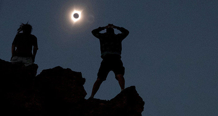 Enthusiasts watch the total solar eclipse from Carroll Rim Trail at Painted Hills near Mitchell, Oregon