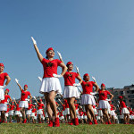 This photo taken on October 8, 2017 shows dancers posing in formation to celebrate the upcoming Party Congress, in Rongan in China's southern Guangxi region. China will convene its 19th Party Congress on October 18, state media said, a key meeting held every five years where President Xi Jinping is expected to receive a second term as the ruling Communist Party's top leader.