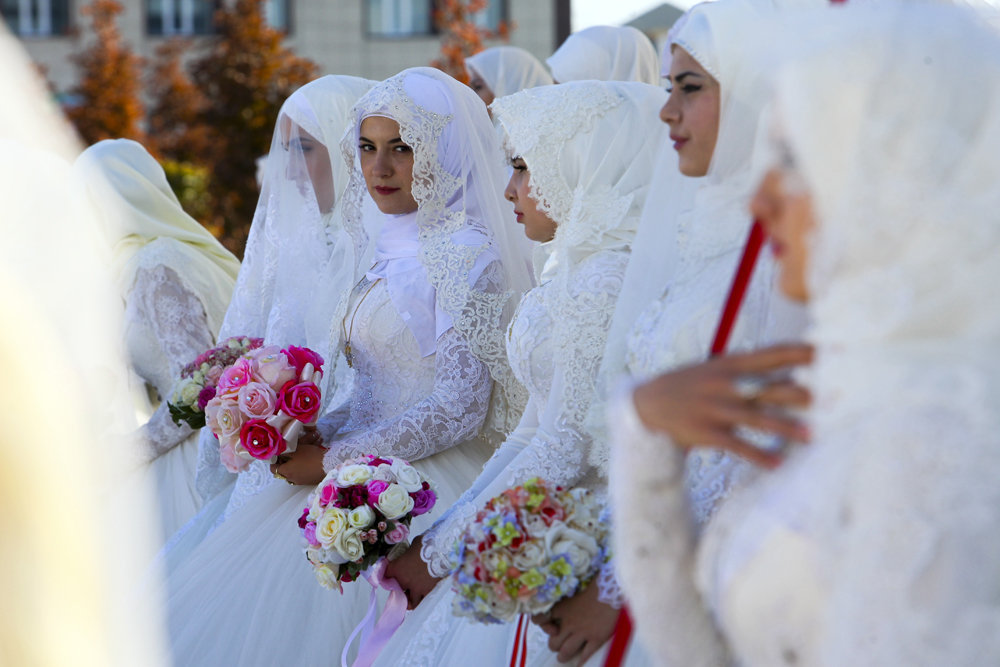 Newly married Chechen couples attend the City Day celebration in Grozny, Russia, Thursday, Oct. 5, 2017. The solemn marriage of 199 couples took place in the flower park of Grozny during the City Day celebration.