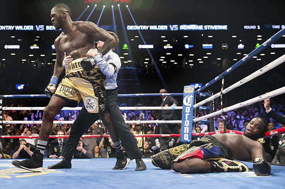 A referee pulls Deontay Wilder away from Bermane Stiverne after Wilder knocked out Stiverne during the WBC Heavyweight World Championship fight Saturday, Nov. 4, 2017, in New York.
