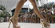 Contenders of Miss Earth 2017, an environmental-themed international beauty pageant, prepare for a group photo by a hotel poolside during the media presentation in Manila, Philippines, Monday, Oct. 30, 2017. Eighty six beauties from all over the world joined the pageant which aims to promote their campaign to save and protect the environment.