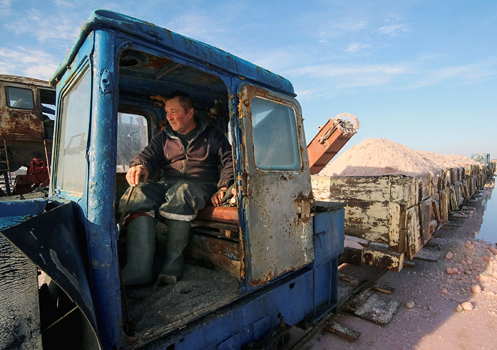 A train driver works at a salt production site at the Sasyk-Sivash lake near the city of Yevpatoria, Crimea